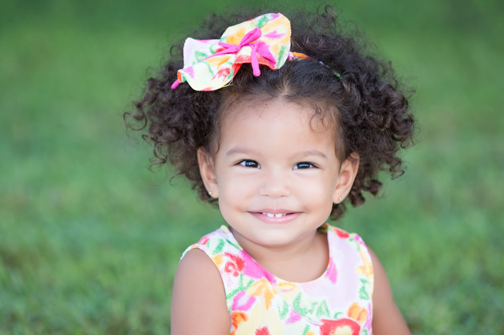 Cute and funny latin girl with an afro hairstyle at a Preschool & Daycare Serving Bordentown, NJ